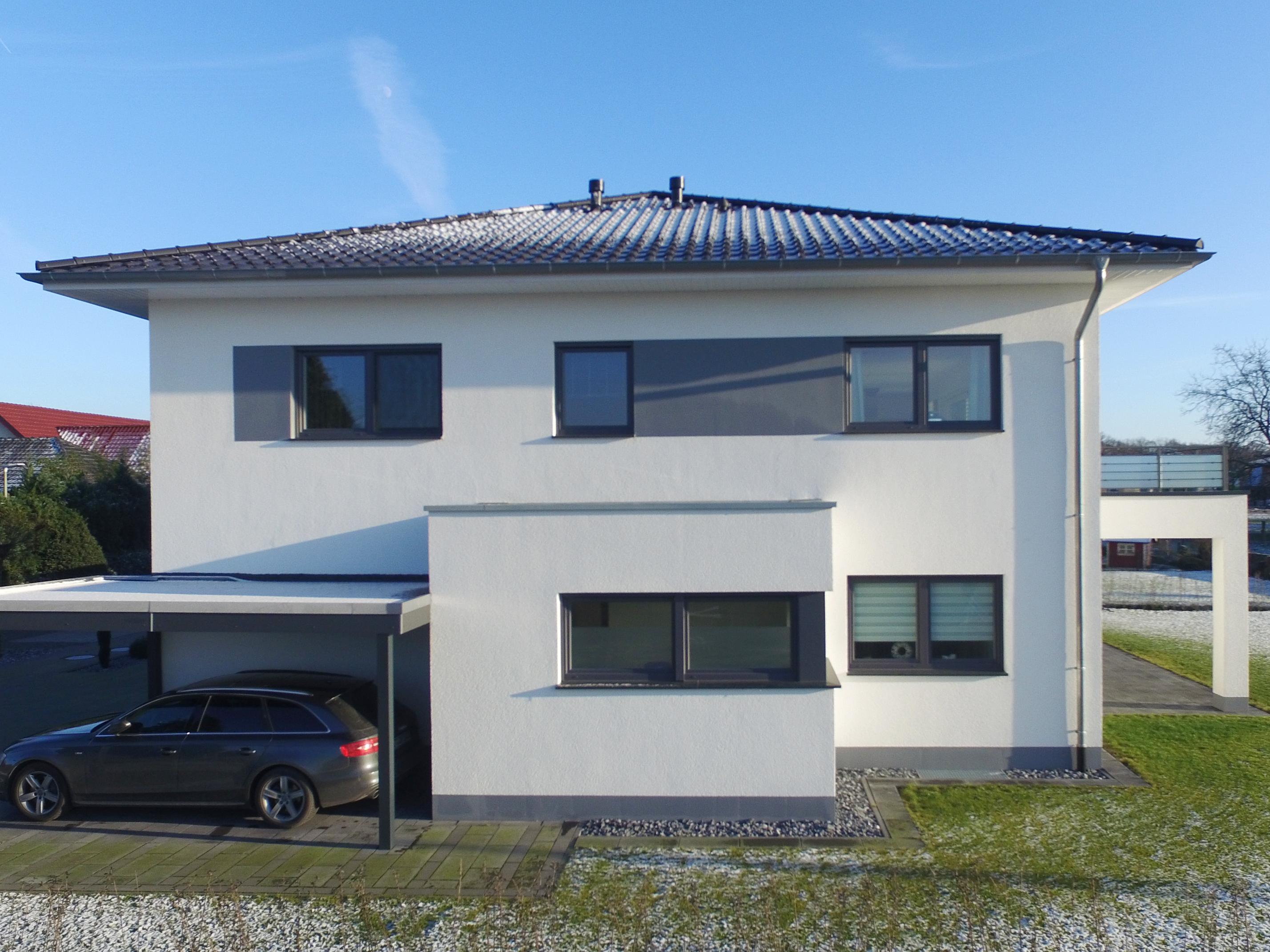 Moderne stadtvilla als zweifamilienhaus vorderbr ggen bau gmbh for Stadtvilla zweifamilienhaus
